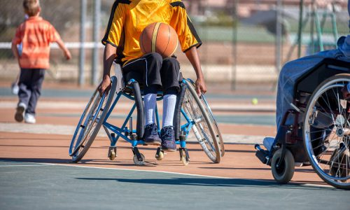 Paraplegic games, basketball players chasing the ball in wheelchairs